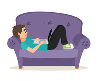 Gamer man lying on sofa with laptop stock illustration