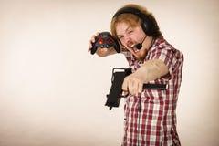 Gamer man shooting from gun Stock Image