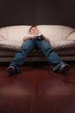 Gamer paresseux Photographie stock libre de droits
