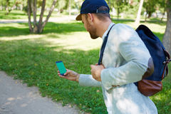 Gamer in park Royalty Free Stock Photos