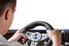Gamer playing in the race behind the wheel Royalty Free Stock Images
