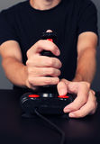 Gamer playing video game with retro joystick Royalty Free Stock Photos