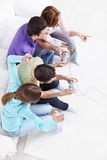 Gamers. Four friends are playing video games Royalty Free Stock Photography