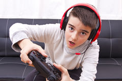 Gamers. Child playing with game console Royalty Free Stock Photo