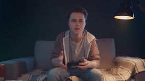Gamers emotions with remote gaming console stock footage