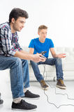 Gamers with joystick. Royalty Free Stock Image