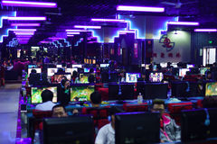 Gamers in night game club. BEIJING-APRIL 26: gamers in night game club on April 26, 2013 in Beijing, China. Gambling is one of problems for teenagers and adult Stock Image