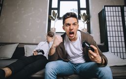 Gamers playing party stock images
