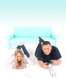 Games!. Girl and man playing games together Royalty Free Stock Photos