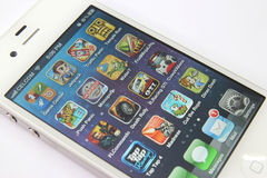 Games Apps on White iPhone 4S. Image of multiple games apps with Game Center on a white iPhone 4S Stock Photo