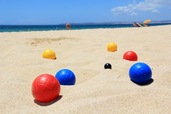 Games on the beach. Coloured bocce balls sitting in the sand. One of many games that can be played on the beach Stock Photo