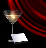 Games card, glass and red drape. Black background, the large glass of champagne or white wine with red drape and abstract empty card Stock Photos