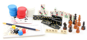 Games Collection. Collection of game pieces including dominos, poker cards and chips, chess, mah jong, and scrabble Royalty Free Stock Images