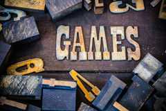 Games Concept Rusty Type. The word GAMES written in rusted metal letters surrounded by vintage wooden and metal letterpress type Royalty Free Stock Photography