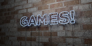 GAMES! - Glowing Neon Sign on stonework wall - 3D rendered royalty free stock illustration Stock Image