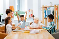 High-spirited kids playing a game all together stock images