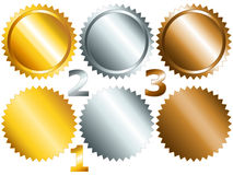 Games medals or labels-set1. Gold, silver and bronze games related set of rosette medal or label with related numbers in metalllic colors stock illustration