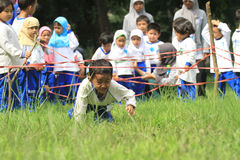 Games Obstacle. Some children are playing hurdles in Solo, Java, Indonesia. The game is to train the child's motor sensitivity to be more responsive in receiving Royalty Free Stock Photos