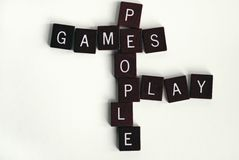 Games People Play #2. Word game with letter tiles.  Concept for psychological games that people play or literal meaning of recreational games. Word play Stock Images