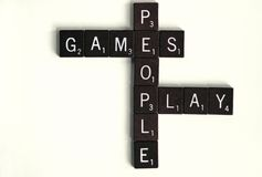 Games People Play. Wooden squares spelling out games people play.  Concept of psychological mind games or manipulation. Word play Royalty Free Stock Photos