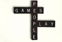 Games People Play. Wooden squares spelling out games people play.  Concept of psychological mind games or manipulation. Word play on Scrabble game Stock Images