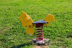 Games at playground - Spring horse Stock Photos