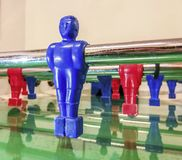 Attacker of a red and blue football table in a game room. In a games room of many residences or Italian hotels you will find table tennis, table football, and stock images