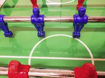 Midfielder of a red and blue football table in a game room. In a games room of many residences or Italian hotels you will find table tennis, table football, and royalty free stock photo
