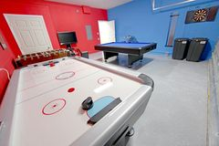 Games Room. A Games Room with Pool, Air Hockey, Foosball and Dart Board Royalty Free Stock Photos