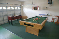 Games Room. A Games Room with Pool Table, Foosball and Darts Board Stock Photos