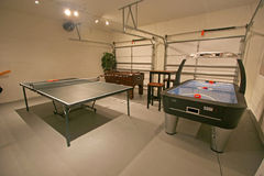 Games Room. A Games Room with Pool Table, Table Tennis and Foosball Stock Photo