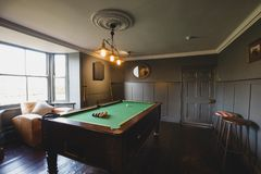 Games Room with a Pool Table. Wide angle view of an interior of a games room in a house stock images
