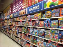 Games in a toy store. Royalty Free Stock Photos