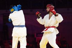 Gamidullaev R. (R) and Razavi R. (B) fight Royalty Free Stock Photos