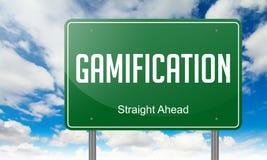 Gamification auf Landstraßen-Wegweiser Stockbild