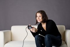 Gaming. A photo of a young woman playing video games Stock Photos