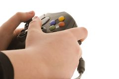 Gaming. Young boy playing a video game royalty free stock photography