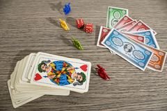 Gaming cards and colored fake money on a wood table. Composition royalty free stock photos