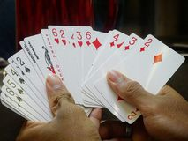 Gaming Cards On Hands Royalty Free Stock Photography