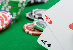 Gaming chips and cards on the green cloth Royalty Free Stock Photography