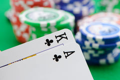Gaming chips and cards on the green cloth Royalty Free Stock Image