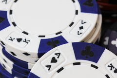 Gaming chips. Close-up of  white and blue poker chips Stock Images