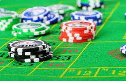 Gaming chips on the green cloth. Casino. High detailed photo Stock Images