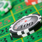Gaming chips on the green cloth Royalty Free Stock Photo