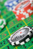 Gaming chips on the green cloth. Casino. High detailed photo Stock Photography