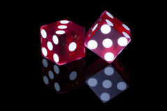 Gaming Dice. Pair of red casino gaming/gambling dice from Las Vegas, Nevada on a black background with reflection stock photos