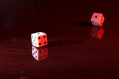 Gaming dice with a red tint. Stock Photos