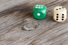 Gaming dice on wooden background Stock Images