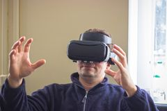 Gaming, entertainment and people concept - senior man with virtual headset or 3d glasses playing videogame. Technology, augmented reality, gaming, entertainment Royalty Free Stock Photography