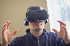 Gaming, entertainment and people concept - senior man with virtual headset. Technology, augmented reality, gaming, entertainment and people concept - senior man Stock Photography